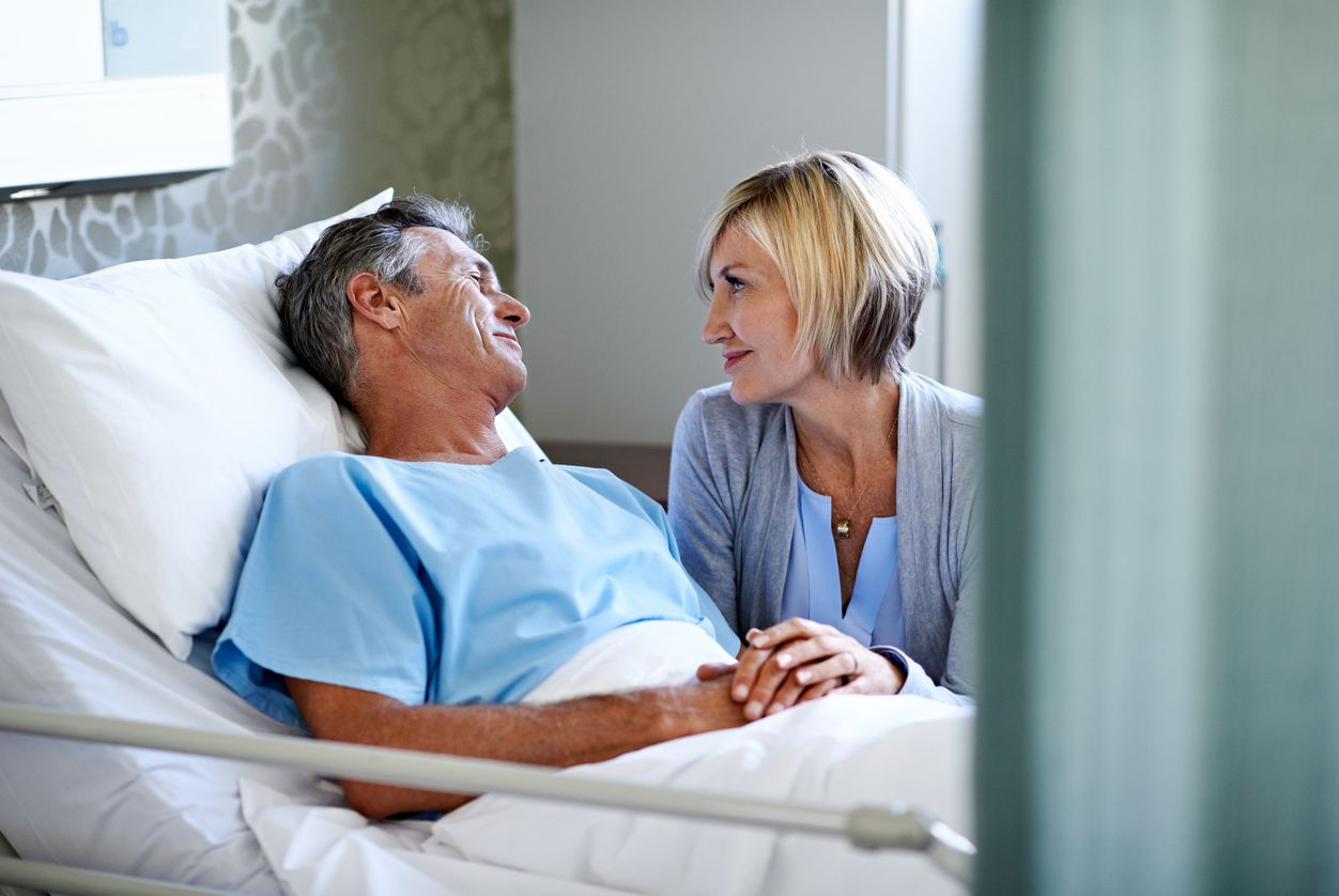 Man in hospital with his wife