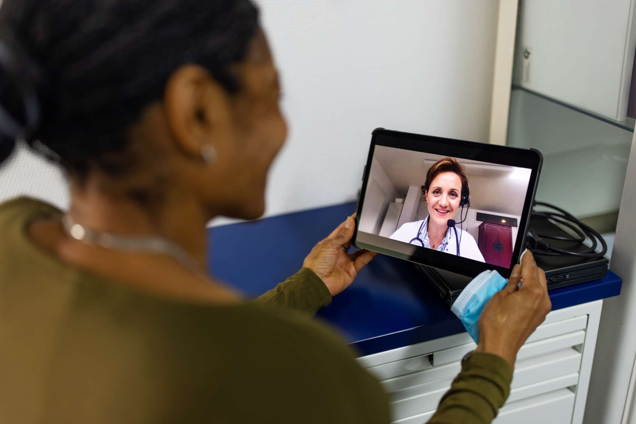 Senior woman on a video call with a doctor