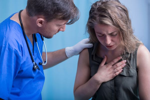 doctor consoling patient