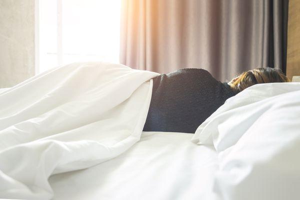 Woman under blanket