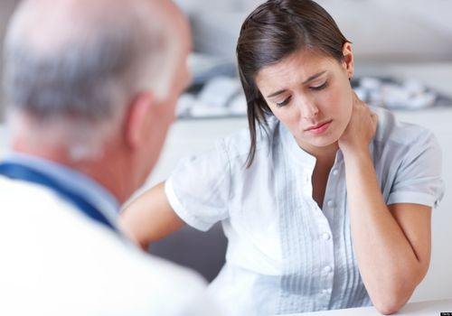 Woman receiving news from doctor