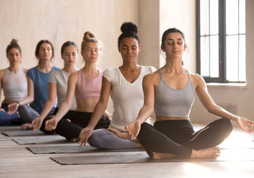 Women in lotus pose.