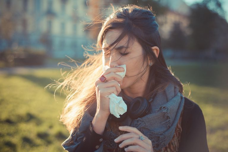 Woman wiping her nose