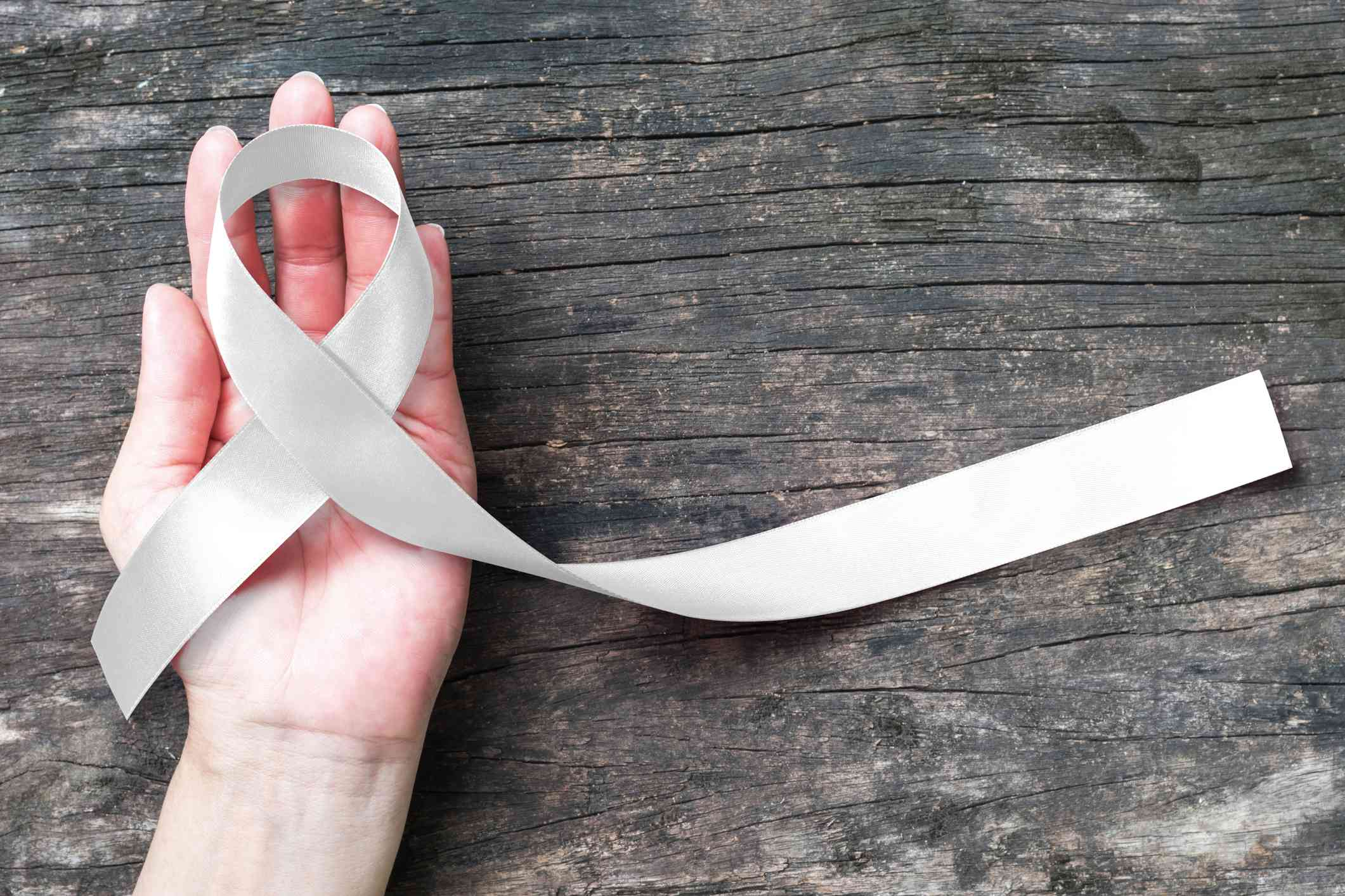 White or light pearl color ribbon for raising awareness on Lung cancer, Bone cancer, Multiple Sclerosis, Severe Combined Immune Deficiency Disease (SCID) and Newborn Screening and symbol
