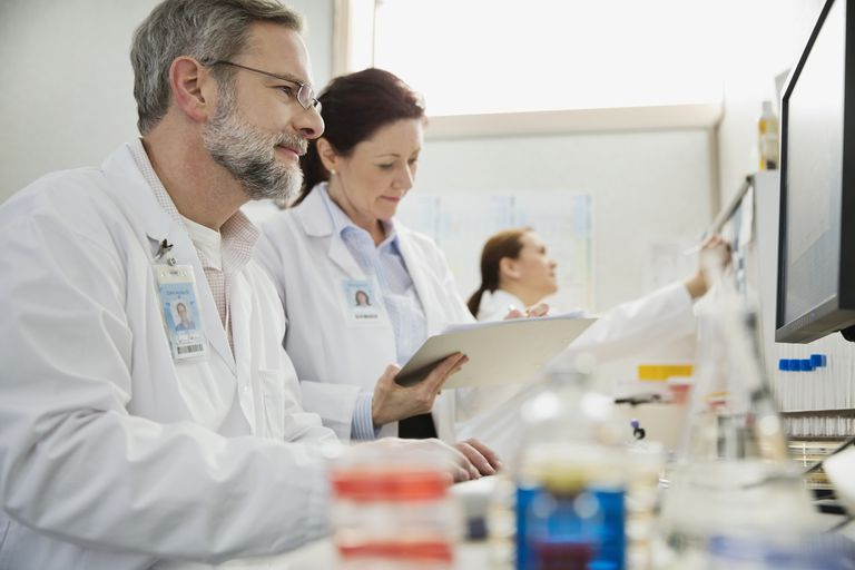 Mature male and female medical professionals working in lab