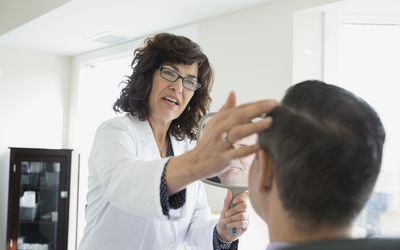 Esthetician working on male client