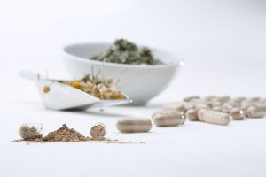 Herbs being ground into supplements