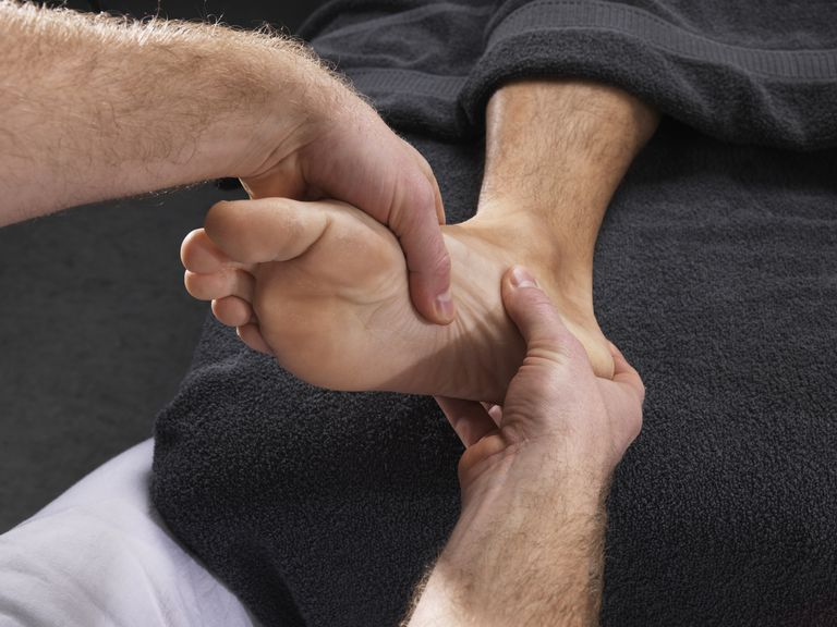 Close up of man having foot massage
