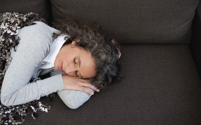 A woman taking a nap on the couch