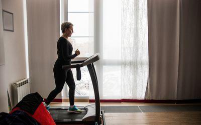 Woman walking on a treadmill.