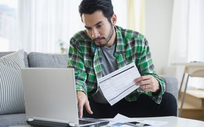 A man is paying bills online