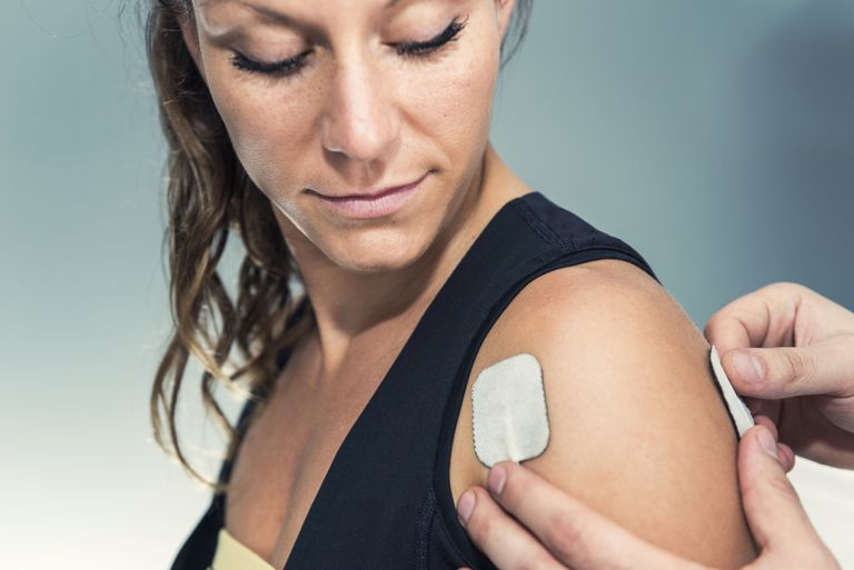 Electrical stimulation applied to a woman's rotator cuff.