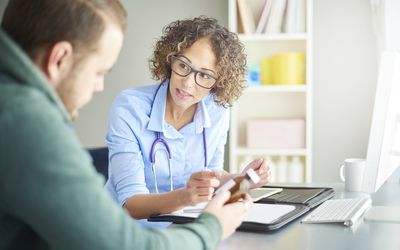 Doctor giving patient prescription drugs