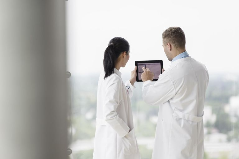 doctors working with tablet computer