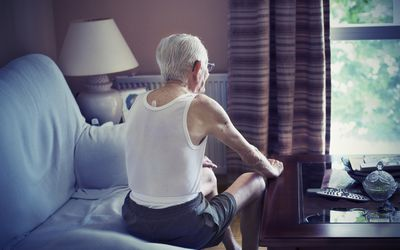 an older man sitting on a couch