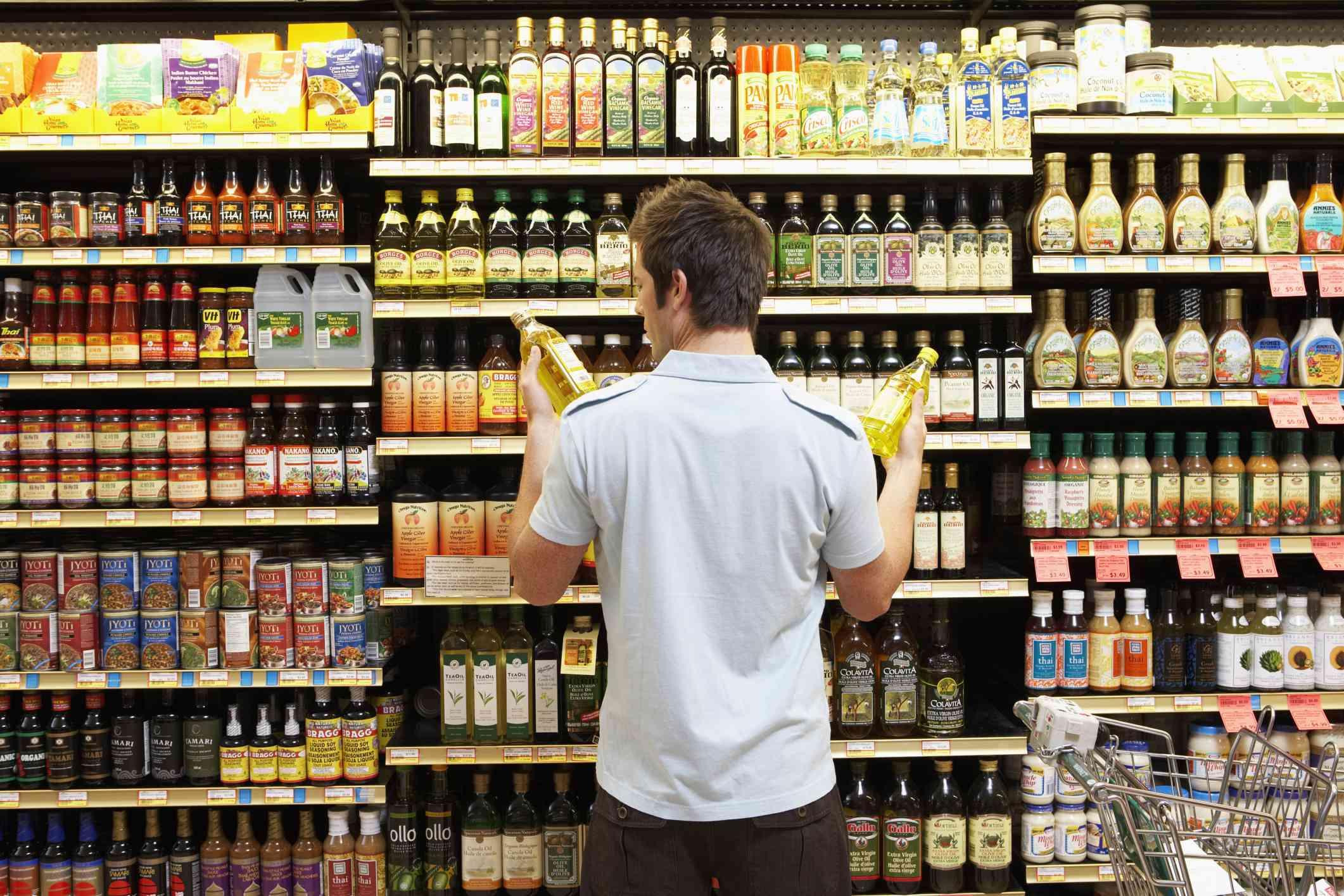 A man deciding between cooking oils