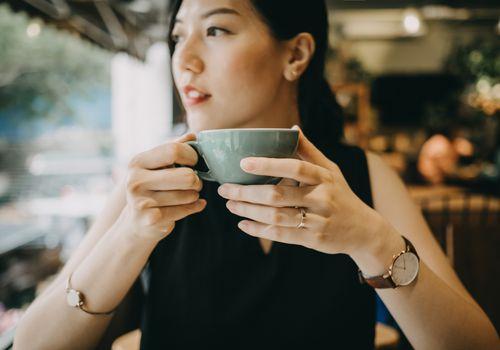 Young woman enjoying tea in cafe