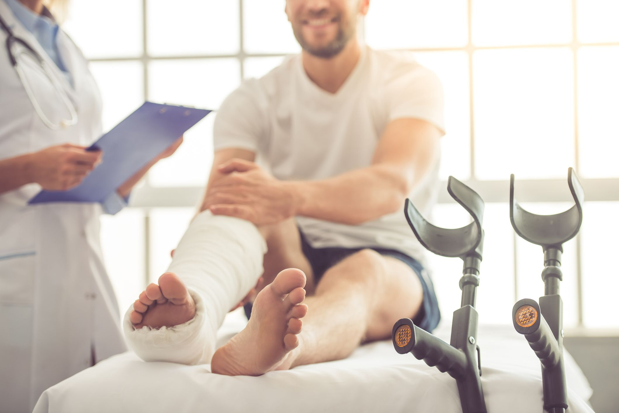 Man in doctor's office with cast on his leg