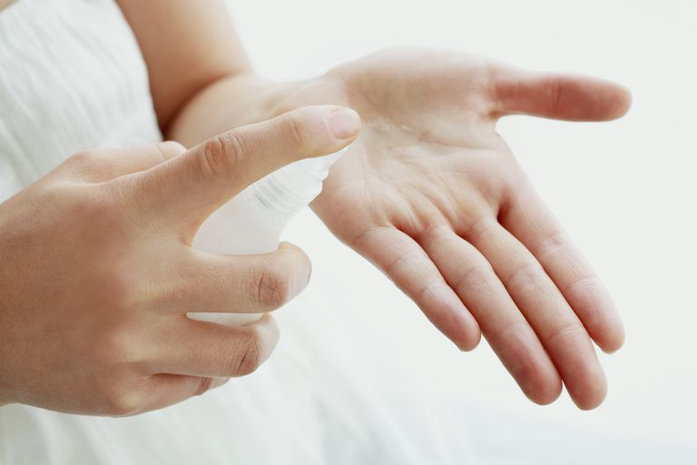 A woman putting lotion in her hand