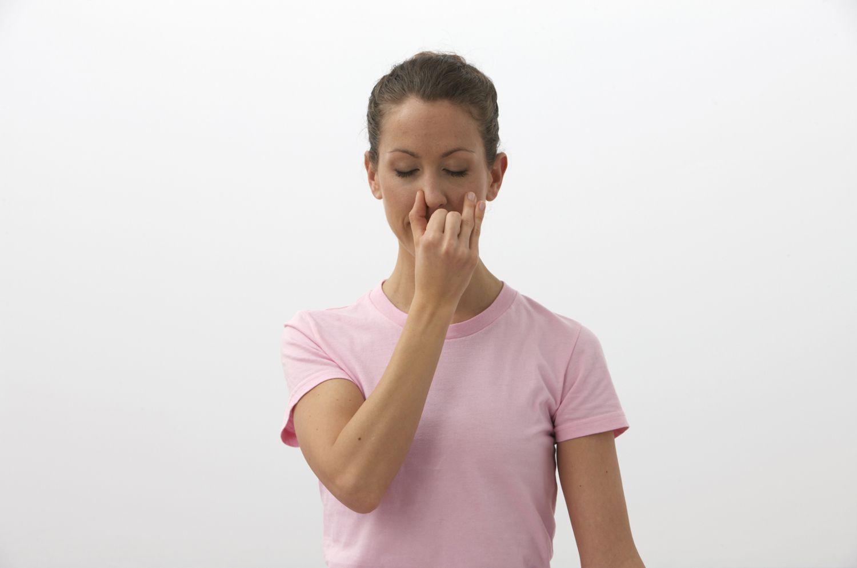 woman demonstrating Alternate Nostril Breathing
