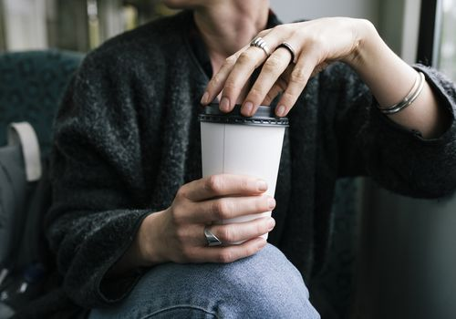 woman holding cup of coffee wondering how it affects her breast cancer risk