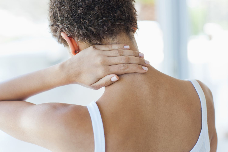 A woman rubbing her sore neck.