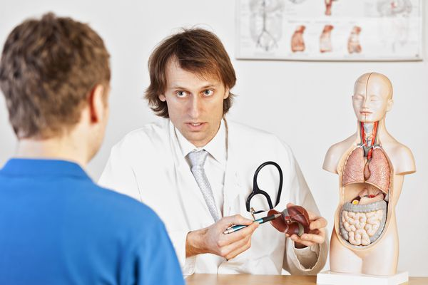 Doctor explaining liver problems