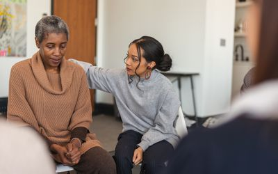 Young woman shows support in therapy session