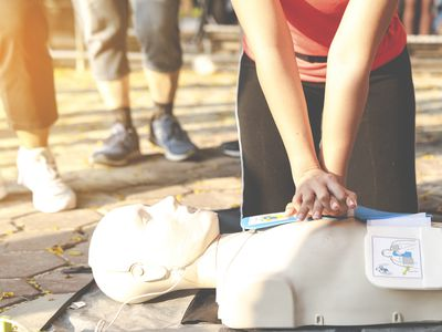 Woman learning how to do CPR