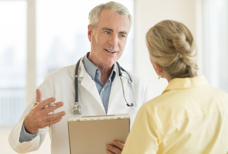 oncologist talking to a patient