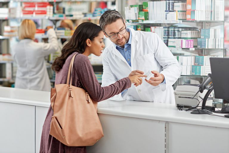 woman talking with pharmacist
