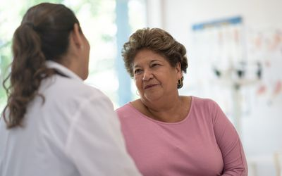 Older Woman talking with the Doctor stock photo