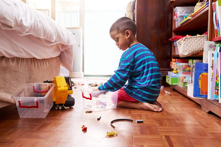 Child playing with toys in room