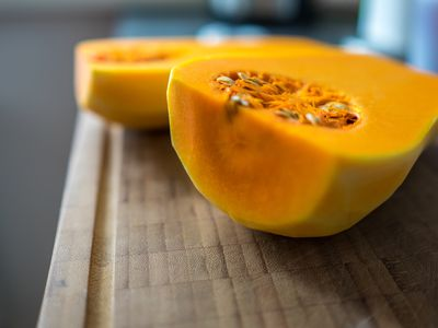 Close-Up Of Halved butternut squash On Wooden Table
