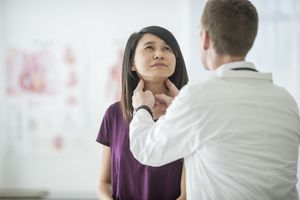 Woman getting thyroid examined