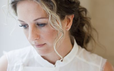 woman looking concerned, worried about her fertility
