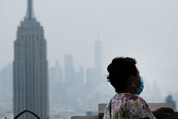 People view the Manhattan skyline as it continues to sit under a haze on July 21, 2021 in New York City