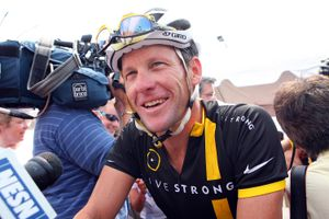 Lance Armstrong on his bike after a race