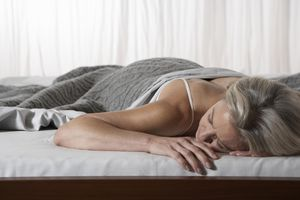 Mature woman sleeping in bed