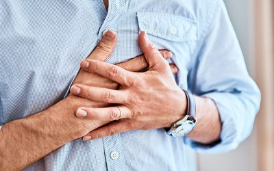 Shortness of breath causes man to clutch his chest