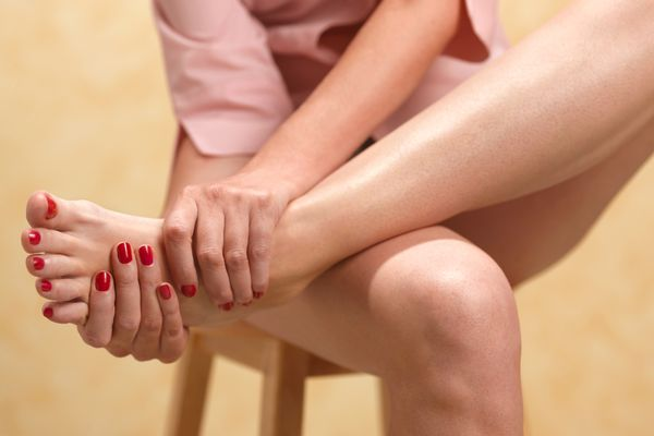 Woman with painful foot from gout.