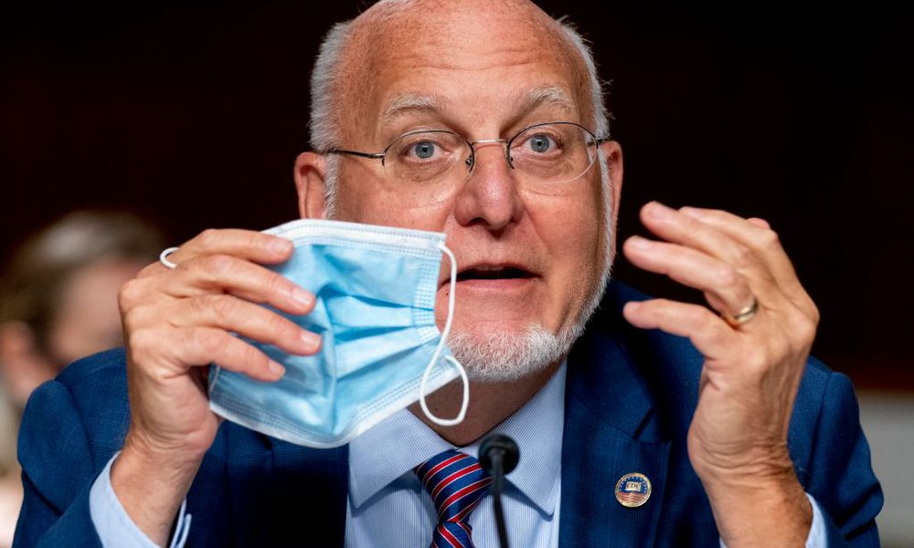 CDC Director Robert Redfield holding a mask