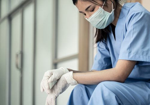 young female healthcare worker taking a break