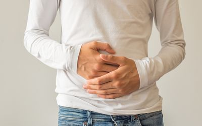 Man with hands on his stomach