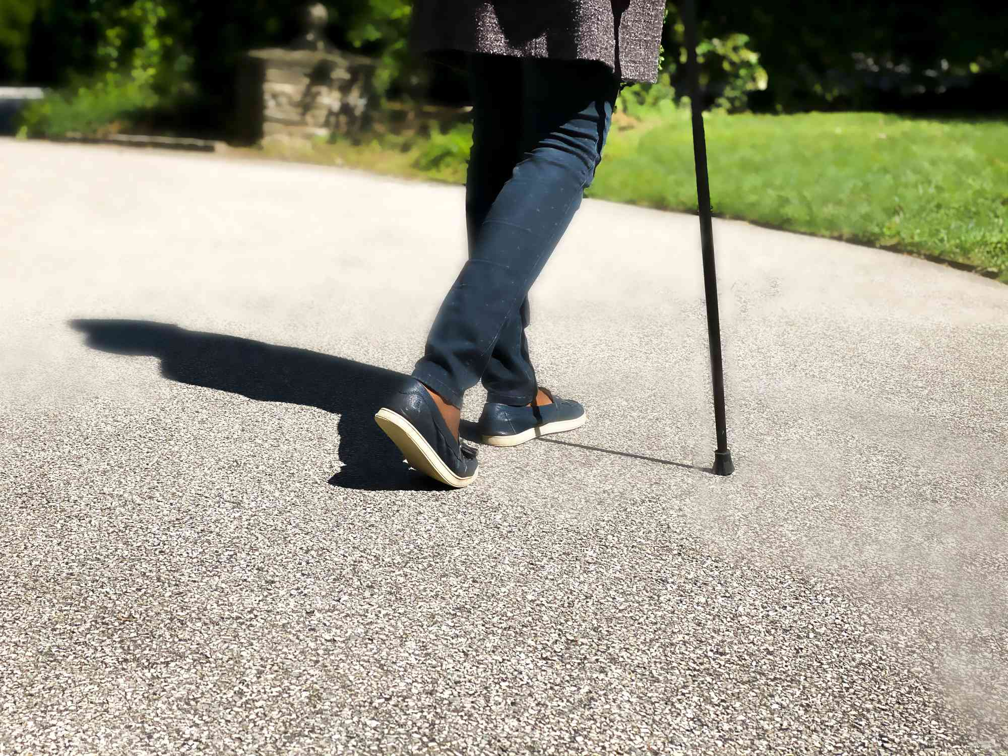 Woman walking with a cane