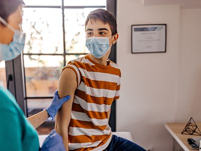 Young teen getting vaccinated.