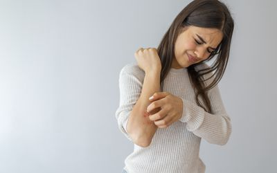 Woman scratch the itch with hand