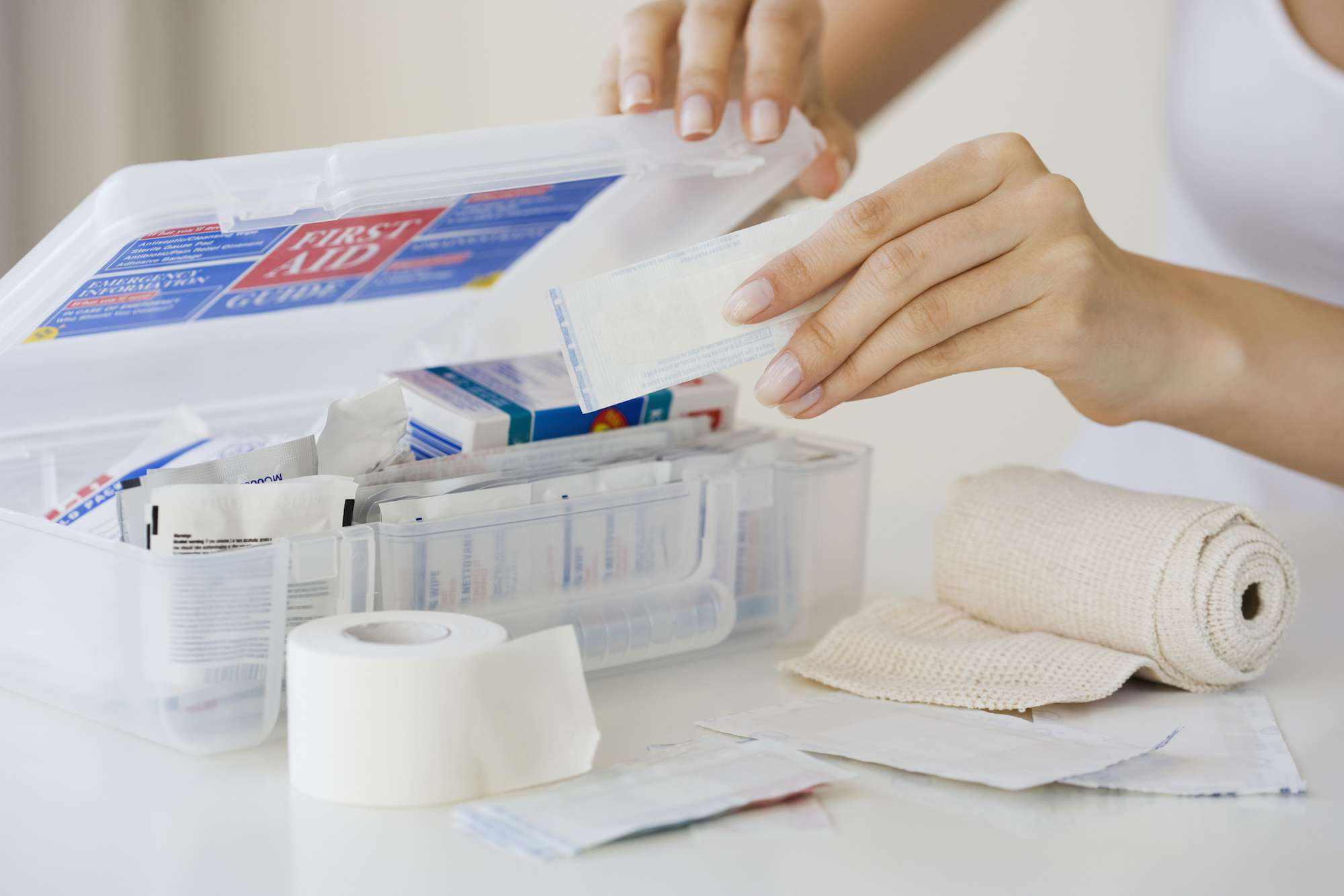 Woman looking at first aid kit