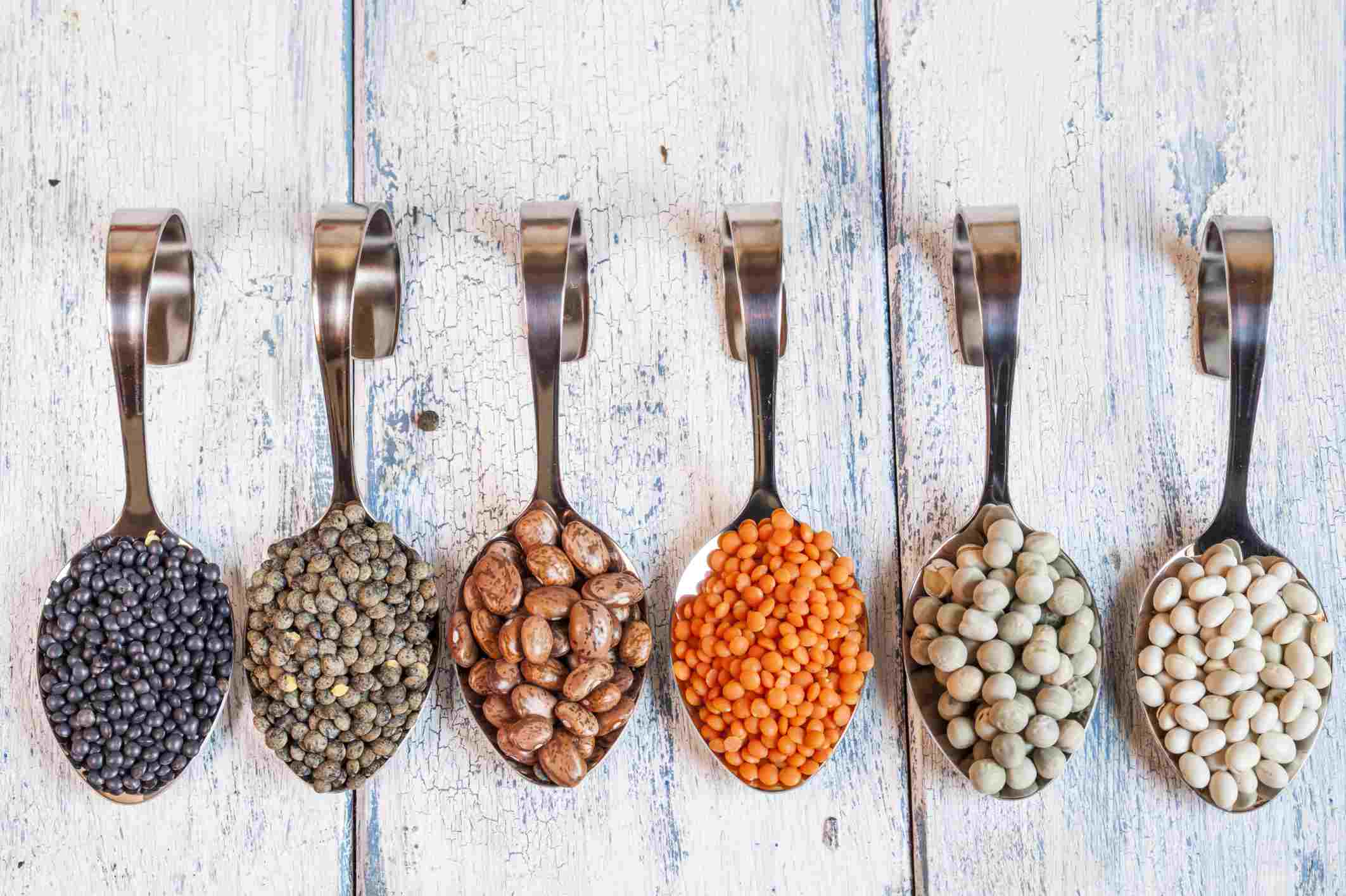 Legumes on different spoons