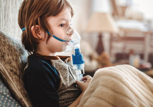 Little boy and nebulizer